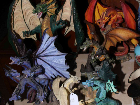 Five large dragon sculptures including Battle of the Dragon and The New...
