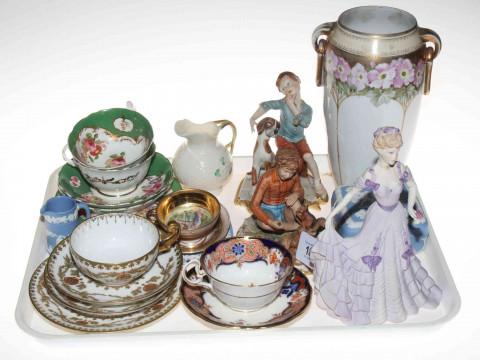 Coalport and Capodimonte figures, cabinet cups and saucers, Belleek jug.