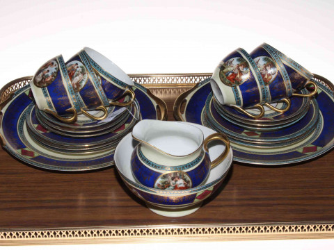 Continental porcelain twenty two piece tea service decorated with classical...