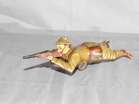 Pre War Einfalt tinplate Sniper with crawling and sparking rifle.   Minor...