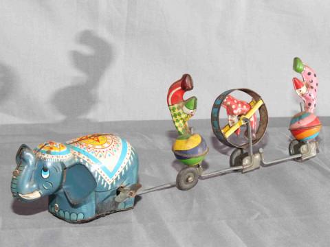 TPS (Japan) clockwork tinplate Elephant towing 3 Clowns.  Excellent clockwork...