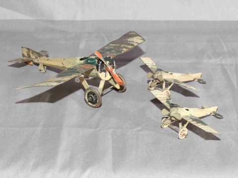 Three early French tinplate Mono planes.  1 being larger scale.   Very...