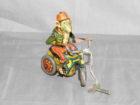 Arnold Germany US Zone clockwork tinplate Monkey on Tricycle.   Very Good...