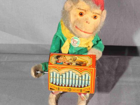 Post War West German clockwork tinplate Monkey playing Barrel Organ....