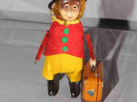 Schuco clockwork Monkey with Suitcase.   Original clothes.  Excellent...