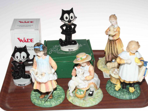 Four Royal Doulton 'Age of Innocence' figures, Puppy Love, Feeding Time,...