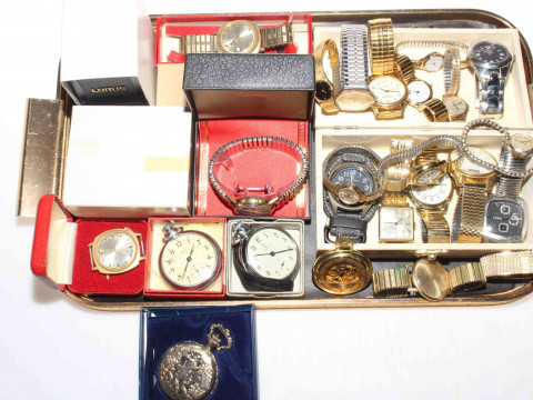 Collection of wrist and pocket watches.