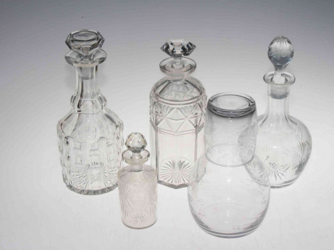 Four glass decanters and stoppers, etched glass carafe and glass, large...