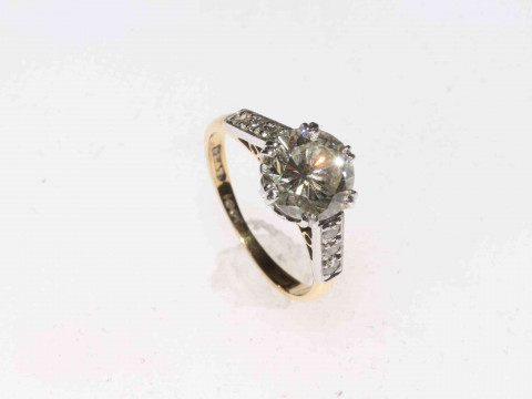 Two carat plus solitaire diamond ring with brilliant shoulders set in 18 carat gold and platinum, size K/L. thumbnail