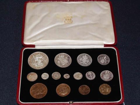 A good George V 1937 specimen coin set within a burgundy red gilt presentation...