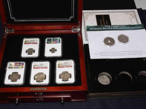 Seven USA coins, all stamped by NGC: 1927 Liberty quarter dollar, 1922...