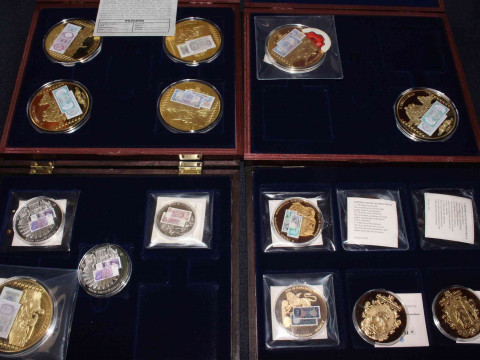 Collection of gold plated and other coins. Including: The History of British...