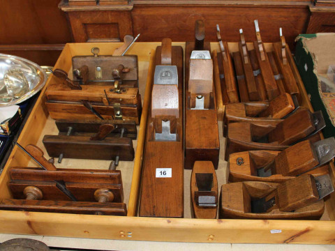 Collection of fifteen wood smoothing and moulding planes.