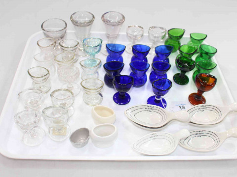 Collection of eye baths, measure spoons, etc.