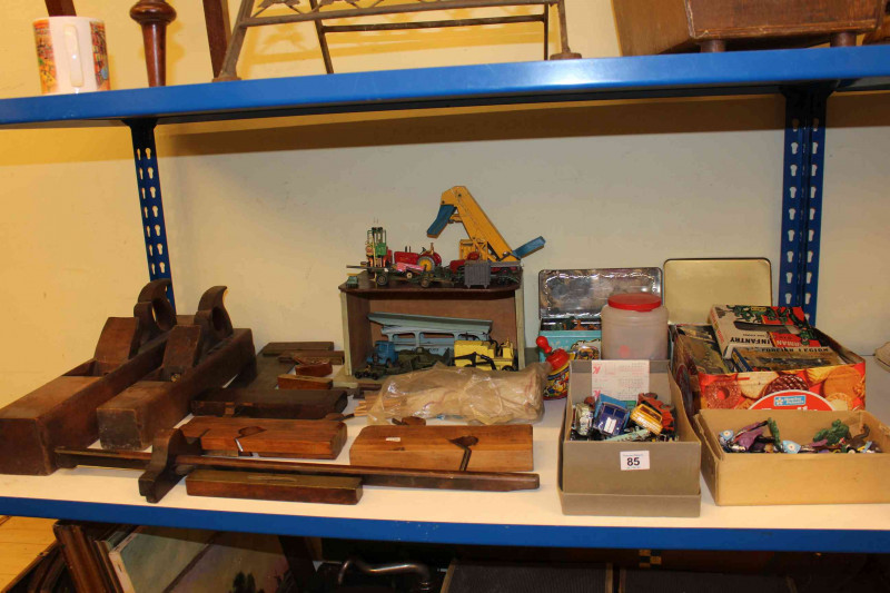 Collection of Corgi and Dinky toys, Airfix and other toys, vintage woodworking tools including planes.