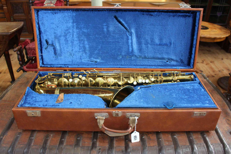 Tenor Saxophone 10M By C G Conn Ltd no.344 563 X instrument, inscribed ' MADE BY C G Conn Ltd Elkhart, Ind. USA' as well as engraving of a Ladies Face, together with a 'Berg Larsen 'mouthpiece. Housed in contemporary hard case with blue velvet lining.