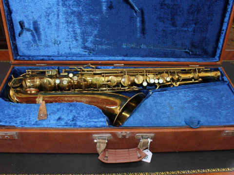 Tenor Saxophone 10M By C G Conn Ltd no.344 563 X instrument, inscribed ' MADE BY C G Conn Ltd Elkhart, Ind. USA' as well as engraving of a Ladies Face, together with a 'Berg Larsen 'mouthpiece. Housed in contemporary hard case with blue velvet lining. thumbnail