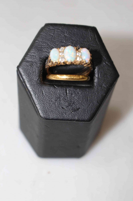 22 carat gold wedding ring and an 18 carat gold opal and diamond ring (missing one diamond) (2).