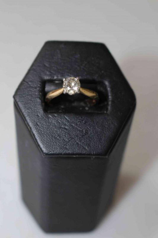 Solitaire diamond 18 carat gold ring, having approximate 0.75 carat diamond, size L.