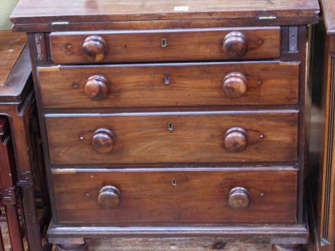 Georgian mahogany bachelor fold top four drawer chest on turned legs,...