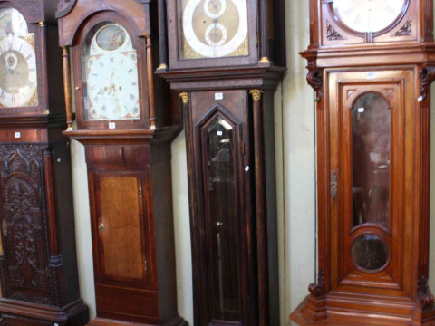 Oak longcase clock with brass and silvered arch dial, single mercury weight...